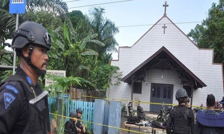 Police stand near the scene of an explosion outside a church in Samarinda, East Kalimantan, Indonesia November 13, 2016 in this photo taken by Antara Foto. Antara Foto/Amirulloh/ via REUTERS
