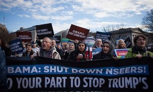 Thousands of Muslim Americans and activists march against Nseers in Washington on 12 December 2016. Photograph: ZUMA Wire/REX/Shutterstock