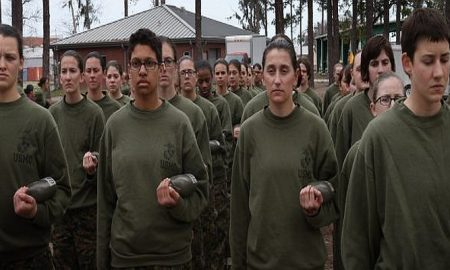 Female Marine recruits stand in formation during pugil stick training in boot camp February 27, 2013 at MCRD Parris Island, South Carolina. Female enlisted Marines have gone through recruit training at the base since 1949. About 11 percent of female recruits who arrive at the boot camp fail to complete the training, which can be physically and mentally demanding. On January 24, 2013 Secretary of Defense Leon Panetta rescinded an order, which had been in place since 1994, that restricted women from being attached to ground combat units. About six percent of enlisted Marines are female. Scott Olson/Getty Images.