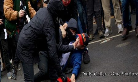 a-protester-chokes-a-trump-supporter-as-they-attempt-to-steal-his-daily-caller-grae-stafford-e1485037092930