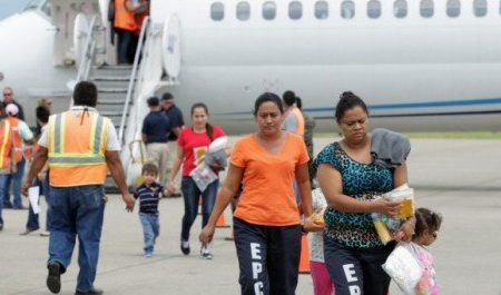 Women and their children walk on the tarmac after being deported from the U.S., at the Ramon Villeda international airport in San Pedro Sula, in this July 14, 2014 handout provided by the Honduran Presidential House. REUTERS/Presidential House/Handout via Reuters