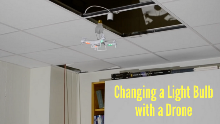 [WATCH] Office Fun: Guy Changes Light Bulb With Drone
