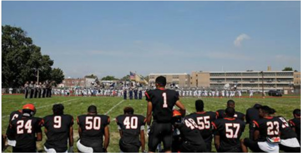 High School Coach And Players Pay Tribute To Colin Kaepernick During National Anthem [VIDEO]