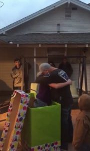 Stepdad hugs stepdaughter after he receives the best birthday gift ever - photo credit - shareably