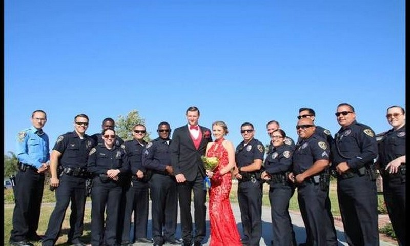Fallen officer's daughter escorted to prom by entire police department