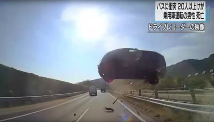 Horror Strikes When Car Flies Across Highway And Smashes Into Tourist Bus [RAW VIDEO]