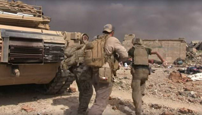 Heart-Stopping Moment Former US Special Forces Soldier Runs Through ISIS Gunfire To Save Girl [RAW VIDEO]