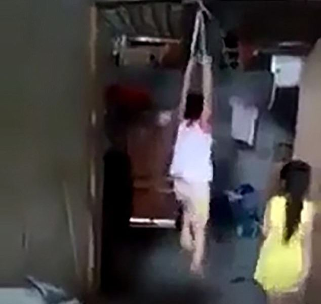 Girl Strung Up By Her Wrists For Drinking a Container of Milk [VIDEO]