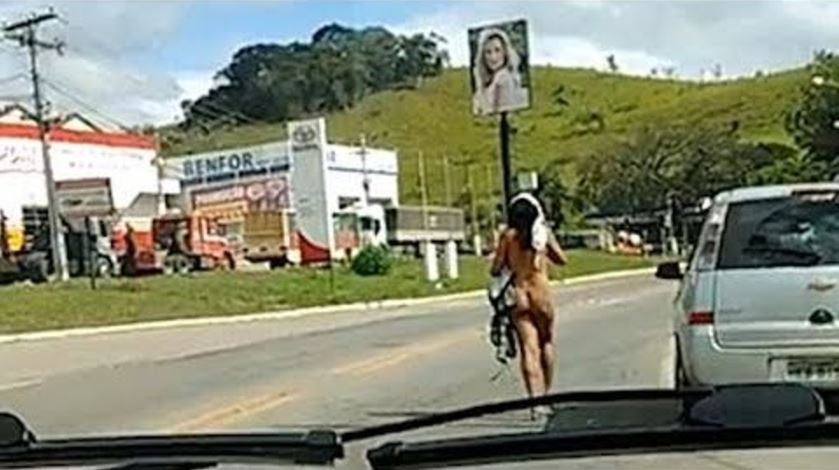 Naked Woman Strutting Around In Intersection Causes Traffic Chaos [VIDEO]