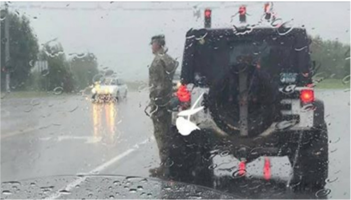 Soldier Stands At Attention In Pouring Rain. When Women Sees Why She Breaks Down In Tears