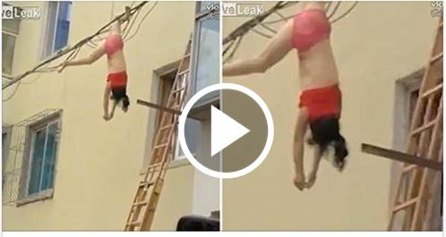 Half-Naked Woman Dangles From Electric Lines After Falling From 4th Floor[VIDEO]