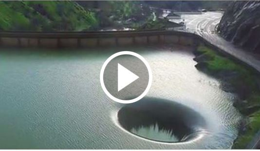 Man Flies Drone Inside & Captures Breathtaking Footage Of Hole In Lake Sparking Curiosity  [VIDEO]