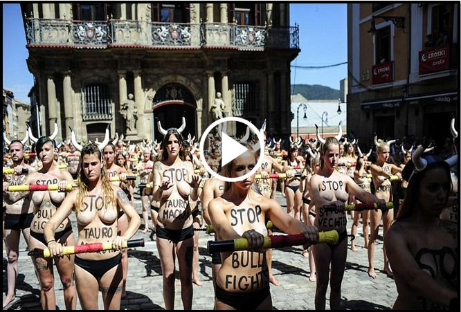 Topless Protestors Rage Against The Running Of The Bulls Festival In Spain [VIDEO]