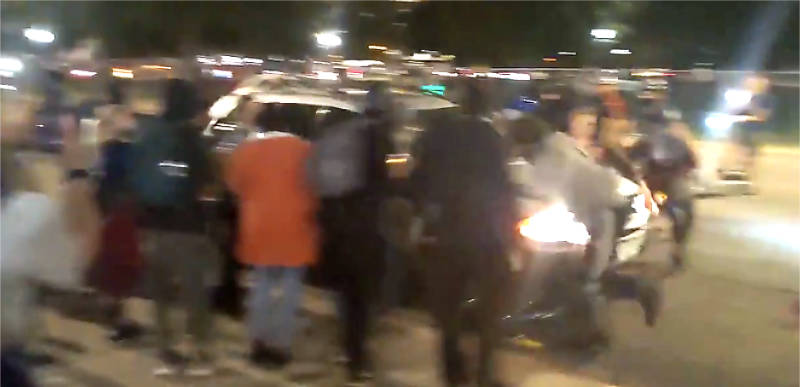 WATCH: Car plows through a group of BLM protesters after they surround vehicle in Denver!